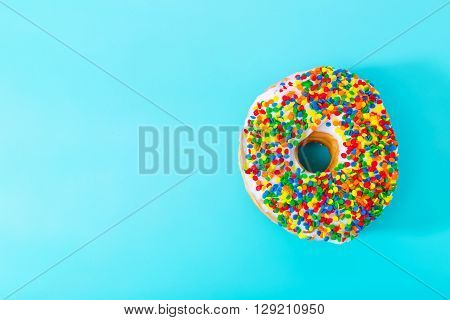 Sprinkled Donut On Pastel Blue Background