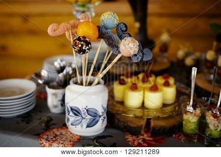 rustic catering service buffet table with delicious sweet food