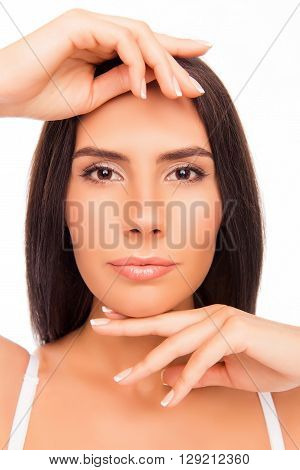 Close Up Portrait Of Calm Brunette Touching Her Chin And Brow