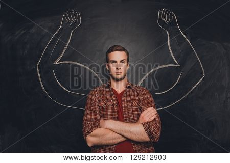 Young Handsome Man In  Shirt With Drawn Powerful Hands