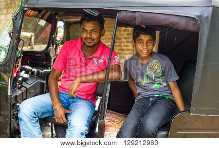 Sigirija Sri Lanka - December 8 2012: Local people smiling in a typical three wheeler taxi
