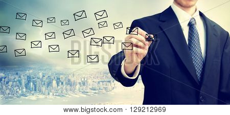 Businessman Drawing E-mail Concept