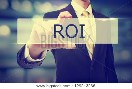 Business Man Holding Roi
