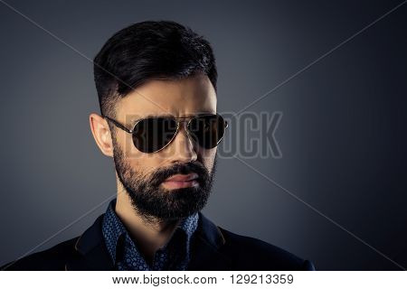 Portrait Of Brutal Handsome Man In Jacket And Spectacles