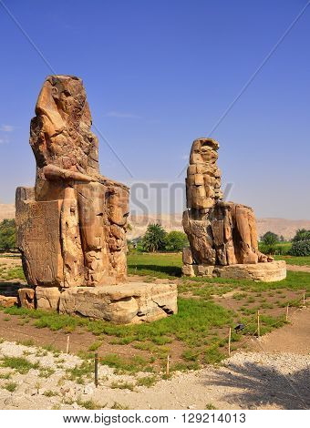 Colossi of Memnon are two gigantic stone statues depicting Pharaoh Amenhotep III