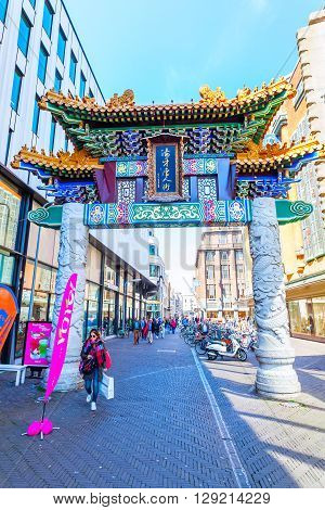The Hague Netherlands - April 21 2016: Chinese Gate at the Chinatown in The Hague with unidentified people. A chinatown is an ethnic enclave of Chinese people and exists throughout the world