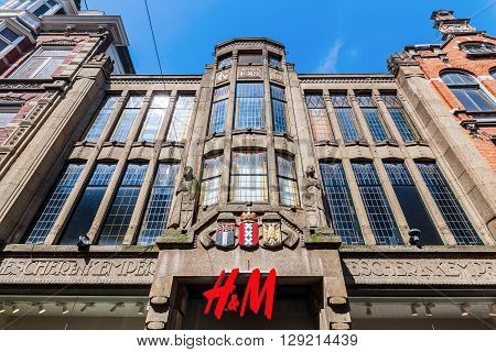 The Hague Netherlands - April 21 2016: historical building with Hennes and Mauritz store. The Hague is seat of the Dutch government and the 3rd largest city of Netherlands with 515880 inhabitants