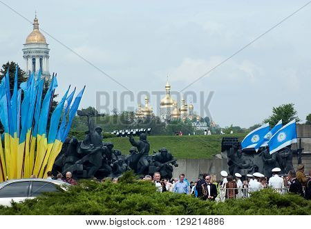 Kyiv, Ukraine - May 8, 2009: Crowd among monuments and flags with churches on the background during Victory Day celebration at the Museum of The History of Ukraine in World War II in Kyiv