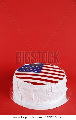 American flag cake, on red background