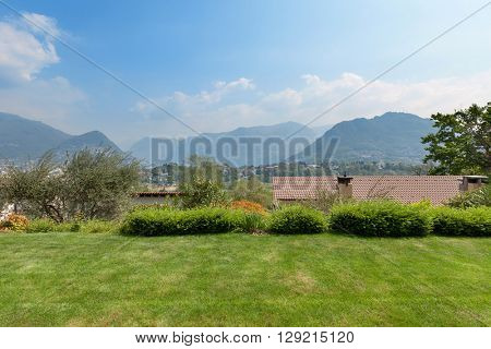 Garden of house, nice view with mountains and blue sky