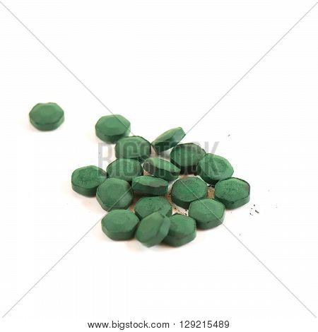 Tablets of Spirulina Algae on the withe background