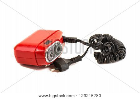 Red vintage electric shaver razor on white background
