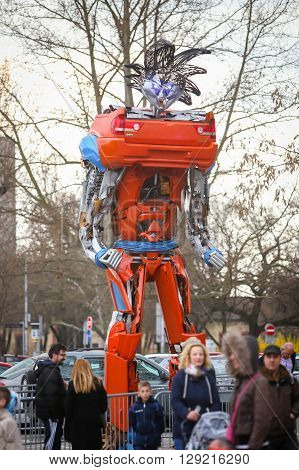 ZAGREBCROATIA- MARCH 262016 : People visiting exhibition by Danilo Baletic named Transformers protecting Zagreb on square Franje Tudjmana in Zagreb. Exhibition is made of automobile parts and waste.