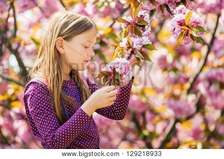 Spring portrait of adorable little girl of 7-8 years old