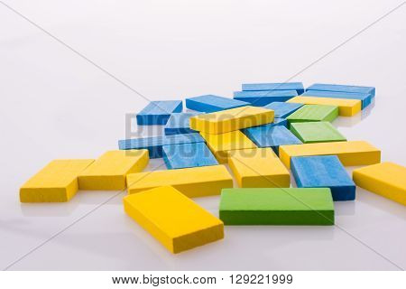 Domino of various color on a white background