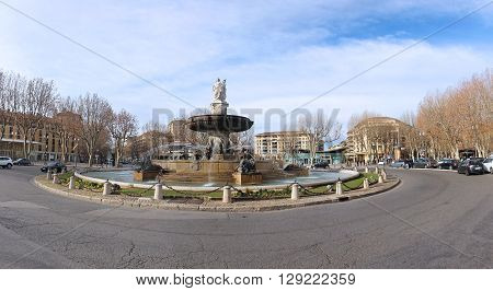 AIX-EN-PROVENCE FRANCE - JANUARY 31; The Fontaine de la Rotonde is a historic fountain with car traffic roundabout in Aix-en-Provence France - January 31 2016