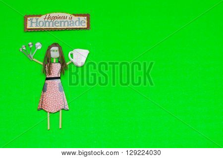 Baker buttonhead stick figure woman with cooking utensils.