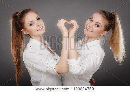Lovely Playful Sisters Women Portrait.