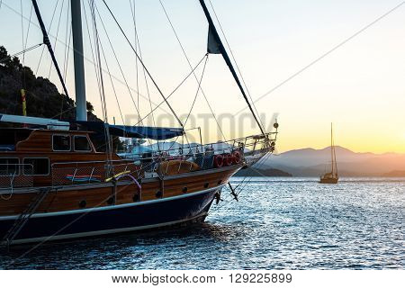 Yacht in sea at sunset