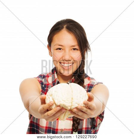 Young smiling Asian girl holding cerebrum model in her hand, isolated on white background