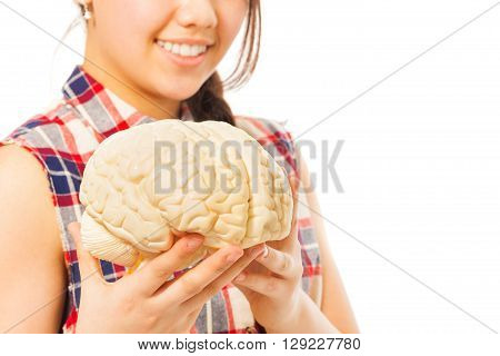 Smiling girl holding cerebrum model in her hands, isolated on white background