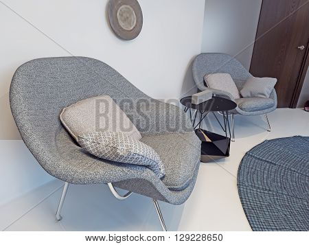 Two armchair and coffe table in front of white wall. 3D render
