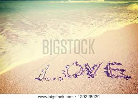 Love Inscribed In The Sand Of A Beach