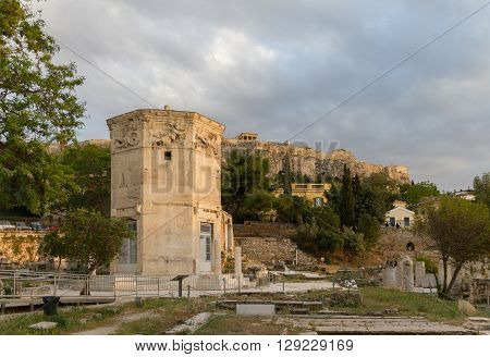 Tower Of The Wind-gods In Roman Agora And Acropolis In The Background
