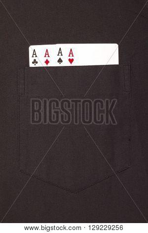 four ace cards inside front pocket black male shirt closeup