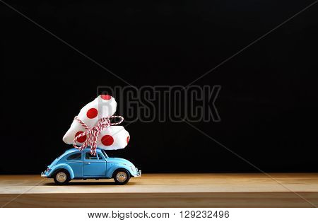 Miniature Blue Car Carrying A Red Heart