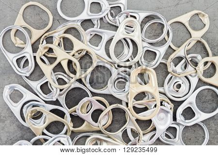 Ring pull cans opener grunge background, stock photo