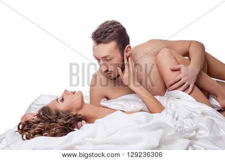 Erotica. Man passionately hugging sexy woman in bed