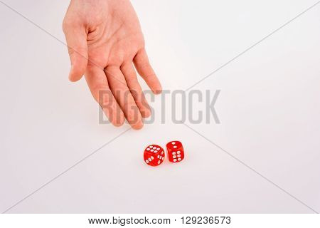 Hand holding red dice on a white background