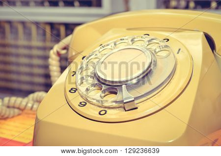 Selective focus of old telephone. Color Retro Style