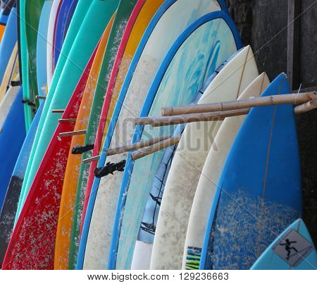 Surfboards background - used surfboards in a row