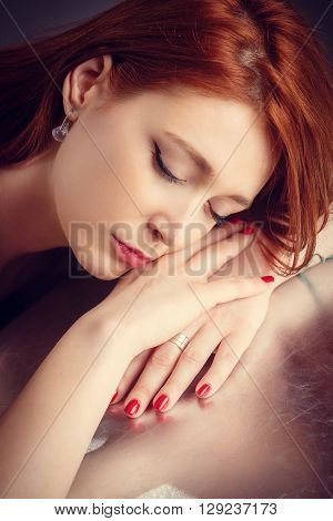Close up portrait of young redhead woman