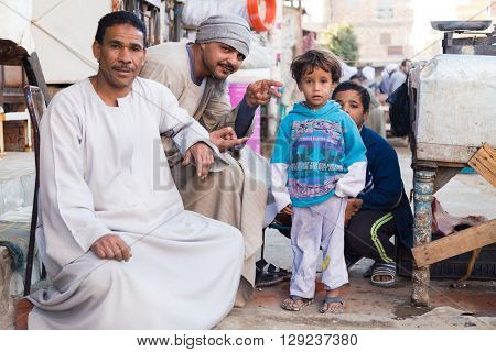 DARAW, EGYPT - FEBRUARY 6, 2016: Local family posing for camera at Daraw market.