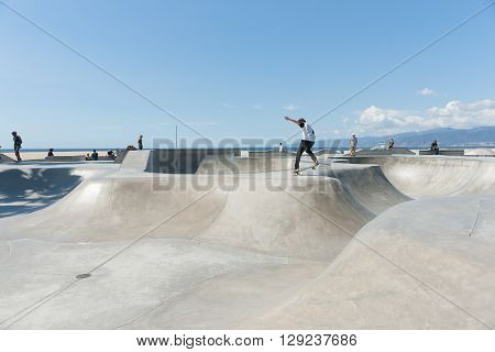 Venice Beach USA October 6 2015; youth action at Skate Park riding their boards at Venice Beach