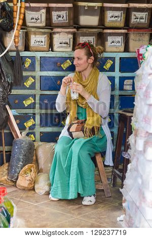 DARAW, EGYPT - FEBRUARY 6, 2016: Tourist having drink at Daraw market.