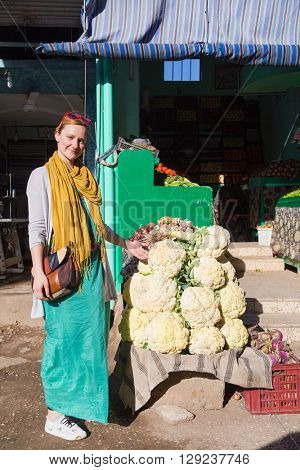 DARAW, EGYPT - FEBRUARY 6, 2016: Tourist standing by the vegetable stand at Daraw market.