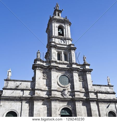 The Carmo Church is a 17th-century church in Braga Portugal with a latin cross floor plan a single nave and the tower facade as the main facade.
