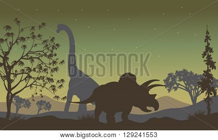 triceratops and Brachiosaurus silhouette in the hills