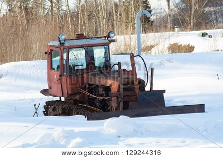 Old brocken rusty tractor in winter field ** Note: Soft Focus at 100%, best at smaller sizes