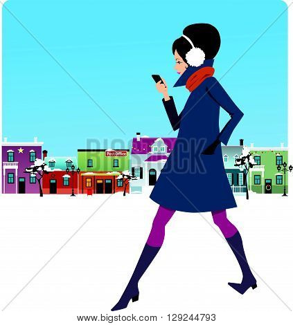 Woman walking down the street and looking at her phone