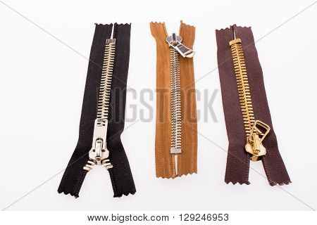 Color zippers of various color on a white background