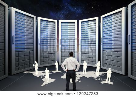 Rear view of classy young businessman posing against server hallway in night sky