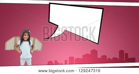 Standing girl with fake wings pretending to be pilot against speech bubble