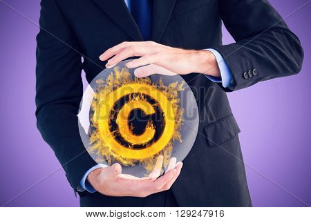 Mid section of a businessman presenting with his hands against purple background