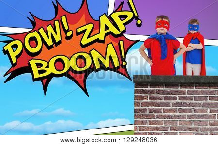 Masked kids pretending to be superheroes against the words pow, zap and boom