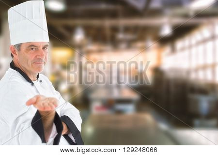 Male chef presenting an invisible product against no one in the room